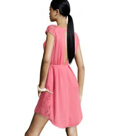 I love the peek-a-boo lace, modest open back and poppy coral color