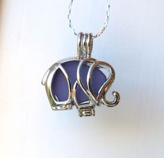 Purple Sea Glass  Elephant Necklace Locket Frosted Pale by WaveofLife on Etsy https://www.etsy.com/listing/220511164/purple-sea-glass-elephant-necklace