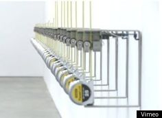 """""""Tape Recorders,"""" which features rows of motorized measuring tapes that grow longer the longer you stay in their line of vision. They grow and grow, until reaching their three meter maximum height and come crashing down, resembling one-armed monsters out to destroy you (tape measures, we're on to you!)."""