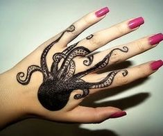Octopus hand tattoo.  Cool, but I would never do it.