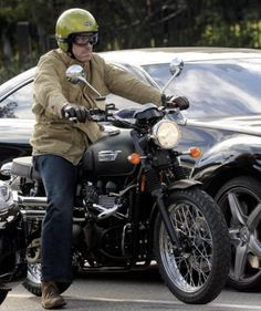 Hugh Laurie looking cool on a Triumph Scrambler
