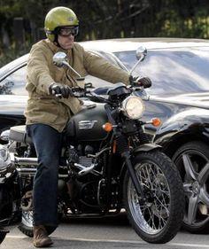 Hugh Laurie looking cool on a Triumph Scrambler