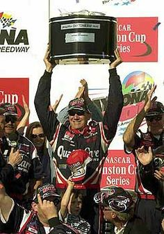 2000 - Dale Jarrett holds up the trophy in Victory Lane after winning the Daytona 500.