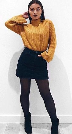 #fall #outfits women's yellow turtle-neck sweater and black high-waist mini skirt