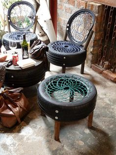 Recycled and repurposed tires into chairs and tables for patio furniture.