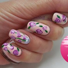 This purple rose-inspired nail tutorial will take your skills to the next level. See the products used to get some nail art inspiration.