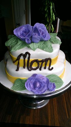 Created by Catharine's Cakes. Mother's Day cake with violet fondant roses.