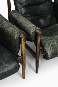 A set of 4 easy chairs in rosewood and green leather at Studio Schalling