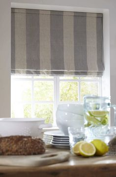 Blue and white striped country kitchen Roman blind made with Cabbages and Roses fabric. Apollo Blinds You Choose! made to measure in any fabric.