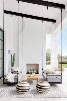 Here is some of my favorite inspiration for outdoor spaces with a modern farmhouse flair. Modern Farmhouse Back Porch - Black Hanging Swings - Modern Outdoor Fireplace - Black and White Back Porch - Home Decor - Home Design - DESIGN: Studio Life/Style Patio Interior, California Homes, California Room, California Style, Design Case, Outdoor Spaces, Outdoor Seating, Garden Seating, Outdoor Retreat