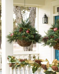 The rustic charm of these Mixed Pine Hanging Baskets instantly add a welcoming touch to your outdoor spaces. Its natural twig baskets are trimmed with fairy light strands for that extra sparkle. On sale in our January Clearance Event! Christmas Hanging Baskets, Outside Christmas Decorations, Christmas Planters, Christmas Porch, Hanging Ornaments, Rustic Christmas, Christmas Lights, Christmas Time, Christmas Wreaths