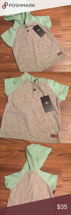 NWT 6-9 mo. 7 for all mankind raglan hooded shirt Baby boy 6-9 mo Henley style raglan shirt in heather grey/mint w/hood. SUPER soft! 7 for all Mankind. Would be super cute on a cute little dude! 7 For All Mankind Shirts & Tops Tees - Short Sleeve
