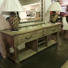 This imported Provincial-style wine storage console table provides elegant and practical storage for your bar necessities! Handcrafted from durable Fruitwood with an intricate onyx inlay top and balustrade legs, it features two large end drawers, two smaller centre drawers, two large open storage shelves, and an open wine rack to display a dozen of your … Read more