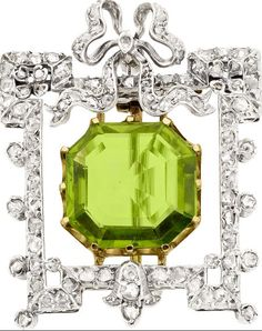 Peridot, Diamond, Silver-Topped Gold Brooch, circa 1900. The brooch features a square emerald-cut peridot measuring 11.75 x 12.00 mm and weighing approximately 6.00 carats, set in 14k gold, enhanced by rose-cut diamonds weighing a total of approximately 1.00 carat, set in silver-topped gold having rhodium finished accents.