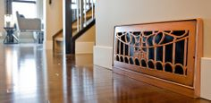 Antique Copper Victorian Vents Inc. return air grille in Sterling show home.