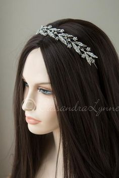 Set in antiqued silver, this wedding headpiece has a Grecian-inspired design…