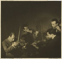 "Olive COTTON Australia 1911 – 2003 The Budapest String Quartet 1937 Sydney, New South Wales, Australia gelatin silver photograph Primary Insc: signed and dated on backing sheet l.r., pencil ""Olive Cotton '37"" titled on backing sheet l.l., pencil ""The Budapest String Quartet"" artist stamp on backing sheet reverse u.l., red ink ""OLIVE COTTON / CALARE BUILDING / COWRA"
