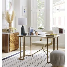 Shop dahlia marble desk.   This beauty just might have you volunteering for a little weekend work.  Old-world elegance of white Banswara marble works a modern angle on a brilliant brass base.