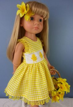 Katie Gotz Happy Kidz in a Salstuff Yellow Gingham Easter Chick Dress with daffodils in her hair. Find Sally Channon on Facebook UK and also Salstuff on Ebay.