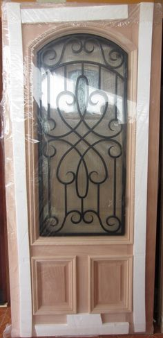 #9 2/3 LITE IRON GRILL MAHOGANY WOOD DOOR | ROBERT'S ELEGANT DOORS FRONT DOORS EXTERIOR WOOD DOORS PATIO DOORS DOUBLE DOORS TEXAS STAR DOORS AFFORDABLE PRICES IN HOUSTON TEXAS