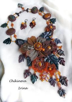 Beautiful embroidered jewelry by Irina Chikineva.  See more on beadsmagic.com