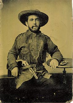 A tintype of a scalp-hunting frontiersman with his Colt 1860 Army. A bounty paid for a scalp depended on the victim's age and sex. That generally meant one hundred dollars for a warrior's scalp, fifty dollars for a squaw's scalp and twenty-five dollars for all children less than 14-years of age.