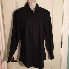 New DKNY Black Button Down Shirt New (without tags) DKNY black button down shirt. DKNY Tops Button Down Shirts