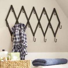 Metal Scissor Rack | This row of hooks brings style to organization, offering the perfect spot to hang jackets, bags, hats or scarves.