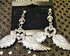 Beautiful Sterling Silver Angel Wing with a heart in the middle to accent dangling pierced earrings.