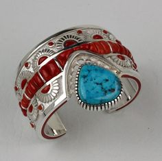 Michael Perry - Sterling Silver Cuff Bracelet  ||  This sterling silver cuff bracelet by artist Michael Perry, is set with Morenci turquoise and inlaid with coral.  $2,495.00