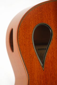 An excellent way to add a unique or modern touch to the aesthetics of a guitar is by changing the shape and position of the soundhole. This can not only give a guitar a dramatic new look, but can have sonic benefits as well. By moving the soundhole up and away from the bridge, the area of the top free to vibrate is significantly increased