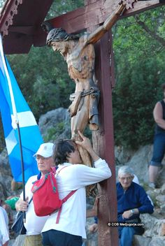 Pilgrim praying on Apparition Mountain June 24, 2013. Thirty second anniversary of Our Lady's apparitions in Medjugorje.