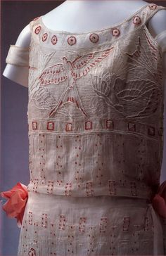 Embroidery by Paul Poiret Made in 1923 a day dress. White linen emb with white thread and beaded with tiny red glass beads LB