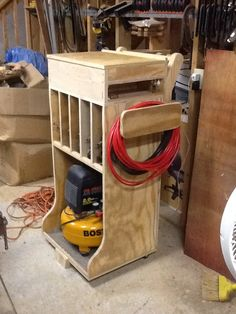 "Woodshop organization. Woodshop air compressor cart. Simple, but now all of my air ""stuff"" is in one place. The pancake compressor, staplers, pinners, and nail guns (plus supplies) are all within reach."