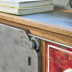 INDUSTRIAL | The Industrial sideboard with antique elm frame stands out for its metal pulley sliding door and customizable hand-made painting on the drawers that make it an exclusive item.  #madeinitaly #design #artigiani #interiordesign #artisans #italian #interiordetails #homedesign #homestlye #wood #artists #interiordecor