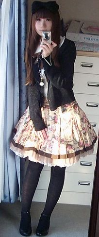 a blouse, a skirt, a cardigan and some overknees or tights and voila you got your own cute casual Lolita Outfit
