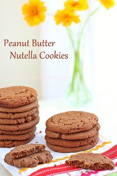 Easy, melt in your mouth peanut butter cookies taken to a whole new level by adding some Nutella to the cookie dough