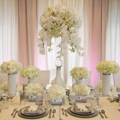 Cinderella #wedding centerpiece theme. Glass white roses and romantic #bouquets. http://www.weddingshoesblog.com/cinderella-inspired-wedding-theme/