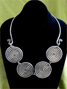 Vintage Hmong Tribal Torc Neckring of Large Antiqued Metal Coils. Handcrafted in the Western Provinces by traditional Hmong tribal jewelry artisans. Spirals almost universally symbolize the unfolding of wisdom and an auspicious destiny.
