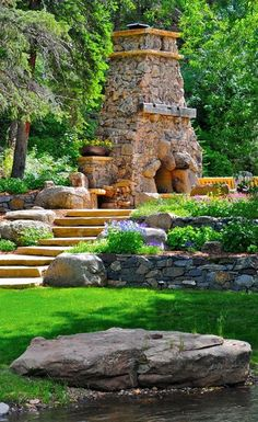 Beautiful free form Hearth.  Love the integrated boulders.  ~~  #Hearth