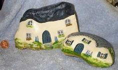 Painted houses on stones