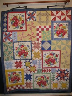 I designed this quilt around repurposed pieces of a 1940's tablecloth I received from my neighbor, Margie.  It's appropriately titled, Margie's Table.