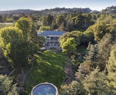 Edie Goetz Mansion, Los Angeles: $79million The #23 most expensive house in America This 14,905 square foot mansion was built in 1938 and soon became the party house for Hollywood elites. At $79,000,000 this 11 bed, 16 bath home also comes with 3, yes 3 guest houses, 2 swimming pools and a tennis court as well as an iconic art deco library