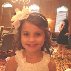 Possibly a headband with a flower for our flower girl Cheyann