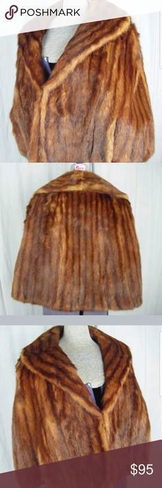 "Vintage 1960s mink cape Vintage 60s Leo Reitner Furs Sherman Oak Reddish Brown Mink Fur Cape  Wide collar 5"" wide Eye hooks for closure at front. 2 arm openings/slits (not sleeves) Fully lined with beautiful flawless silk No issues with fur   Measurement in INCHES (lay flat, side to side):  Shoulder-  16""  Hem width- 30"" Body length  on Shoulder to hem- 21"" Vintage Jackets & Coats Capes"