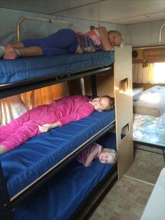Triple bunk made from garage shelving from Bunnings. Mattresses from Clarke rubber.