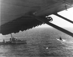 Destroyer HMS Malcolm approaching German submarine U-541 after the U-Boat surrendered pursuant to Germanys surrender terms 11 May 1945 off Portugal photographed from a PBY from VPB-63.