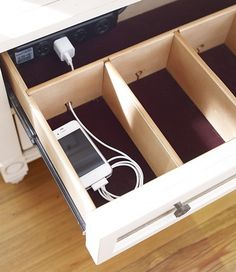 charging station drawer on island | iPad, iPad mini, 2 cell phone spaces + 1 above for iPod & bluetooth