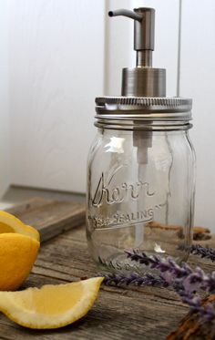 I like the dispenser on ths one... Country Kitchen Clear Mason Jar Soap Dispenser by TheHoneyShack