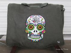 Sugar Skull Backpack, Day of the Dead, Mexican Skull Calavera Bag Canvas Backpack Army Bag, Dia de los Muertos Flower Skull, Halloween Bag by DesignByWendyBgd on Etsy Sugar skull, calavera, traditional motive of the Day of the Dead, hand painted on a vintage Yugoslav Army (JNA) backpack convertible to messenger bag. Water resistant, multifunctional bag: ideal as hiking bag, diaper bag, book bag, school bag... #sugarskull #dayofthedead #diadelosmuertos #calavera #calaveras #skull #flowerskull